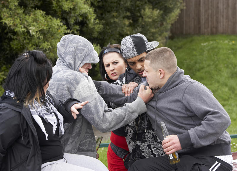Gang Of Youths Fighting. And grabbing each other royalty free stock photos