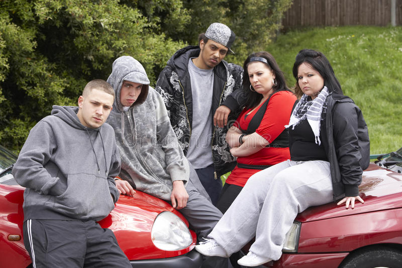 Gang Of Youths Sitting On Cars. Looking at camera royalty free stock images