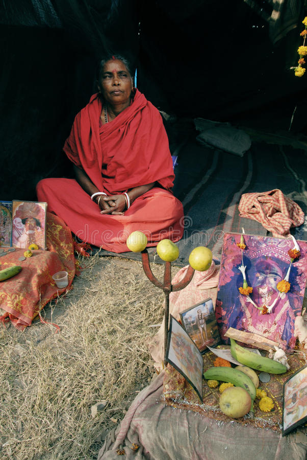 Ganga Sagar festival in India. January 13, 2011-Ganga sagar, West Bengal, India –A woman saint at the fair ground of Ganga sagar. Gangasagar Mela is the royalty free stock photo