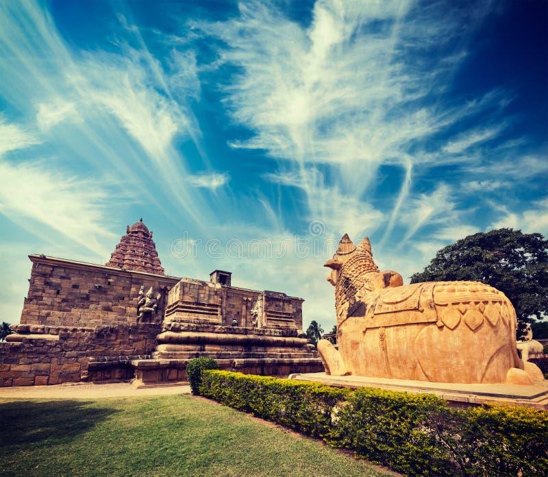 Gangai Konda Cholapuram Temple. Tamil Nadu, India. Vintage retro hipster style travel image of Hindu temple Gangai Konda Cholapuram with giant statue of bull stock photography