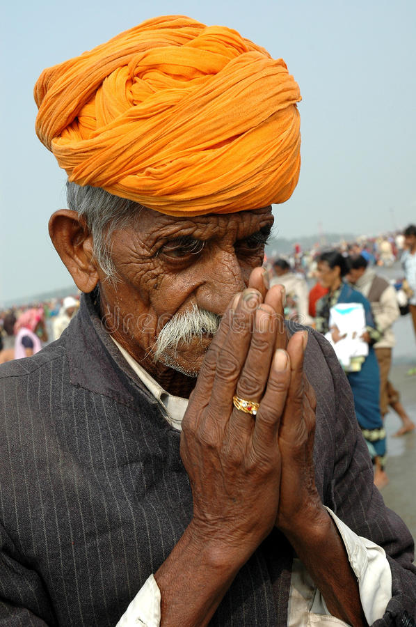 Gangasagar Festival In India. January 14, 2009-Ganga sagar, West Bengal, India -AN OLD MAN SINGING RELIGIOUS SONG AT THE FAIR GROUND. Gangasagar Mela is the royalty free stock photo