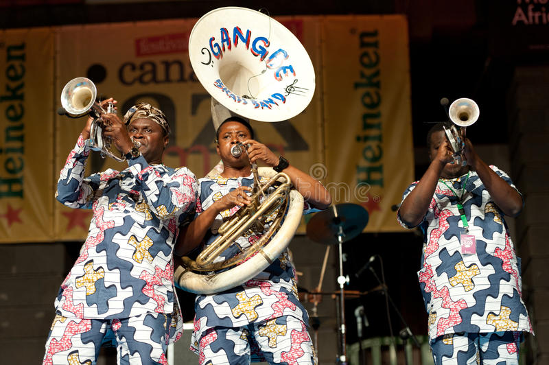 Gangbe Brass Band. CANARY ISLANDS - JULY 8:Musicians from Gangbe Brass Band, from Cotonou-Benin in West Africa, performing onstage during Festival Canarias Jazz royalty free stock images