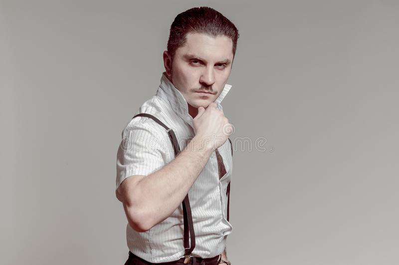 Gangsta Italian man posing with serious face royalty free stock image