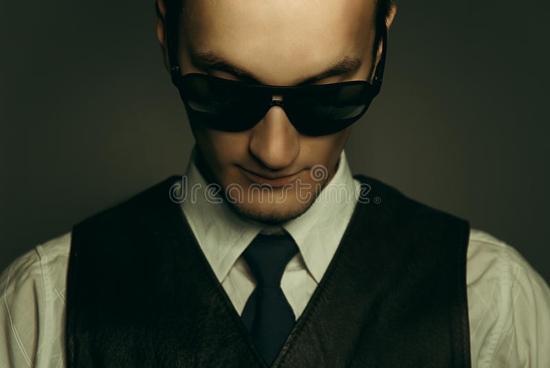 A gangster. An old style image of a gangster in a suit and tie royalty free stock photography