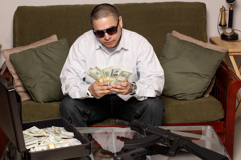 Gangster. With bundles of cash, and guns stock images