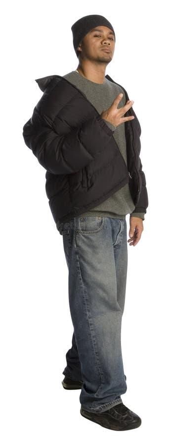 Gangster. Filipino man pretending to be a gang member and flashing a fake gang sign stock photography