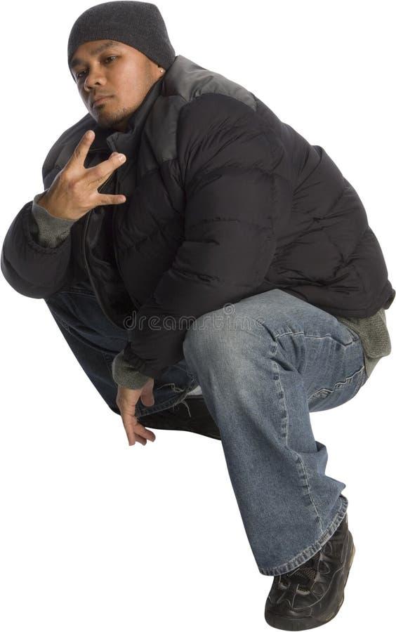 Gangster. Filipino man pretending to be a gang member and flashing a fake gang sign royalty free stock images