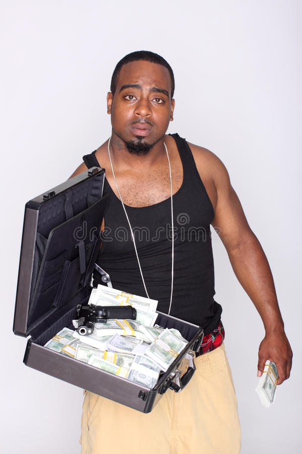 Gangster with cash and gun stock images