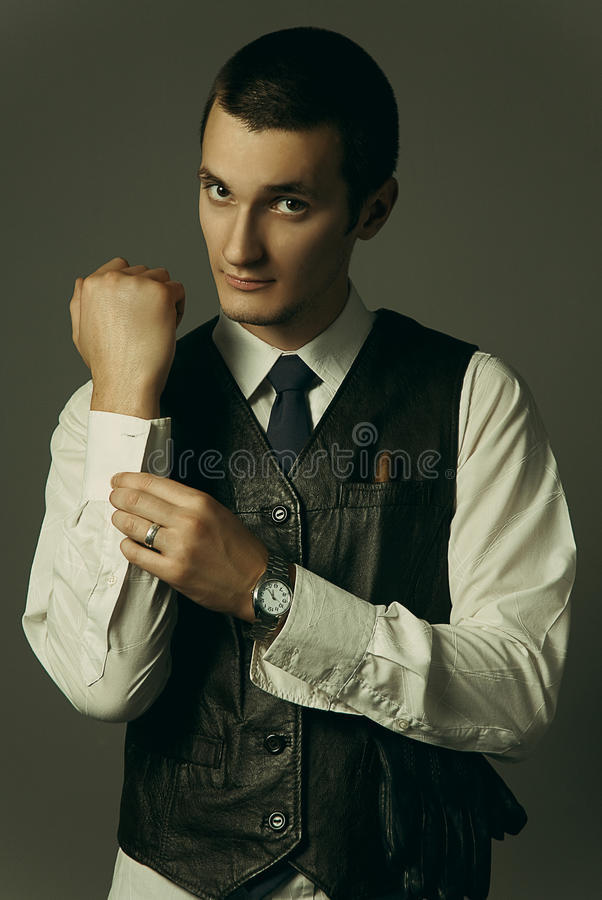 A gangster is getting dressed. An old style image of a gangster in a suit and tie stock photography