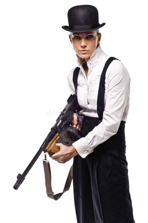 Gangster girl holding thompson machine gun royalty free stock photography