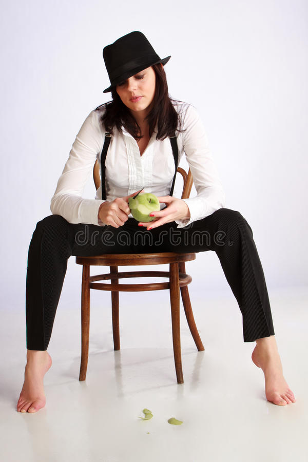 Download Gangster-girl Sitting On Chair Stock Image - Image: 19163055