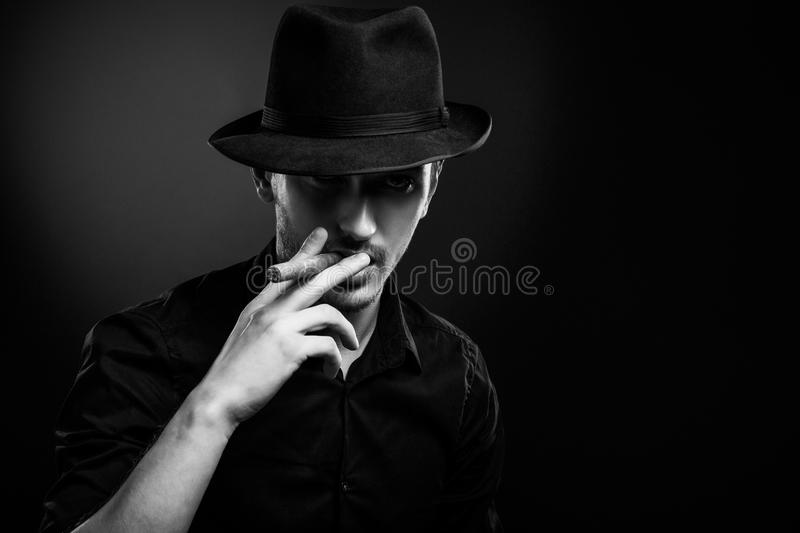 Gangster look. Man with hat and cigar. royalty free stock image