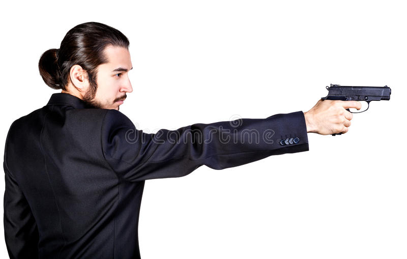 Gangster man in black suit aiming gun royalty free stock photos