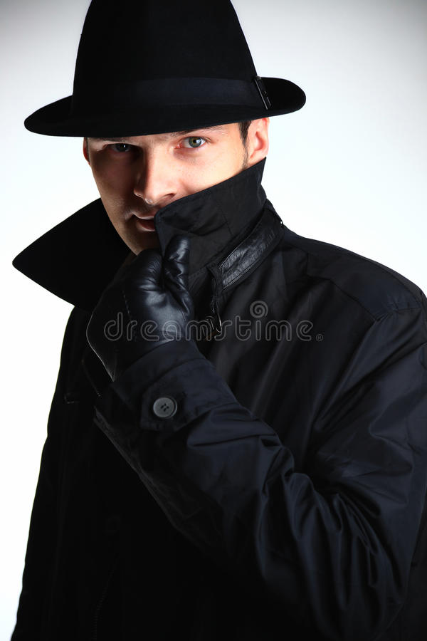 Gangster man in hat and coat stock images