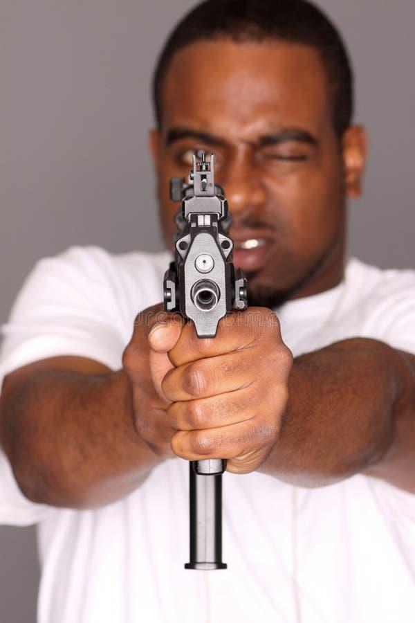 Gangster met kanon stock afbeelding