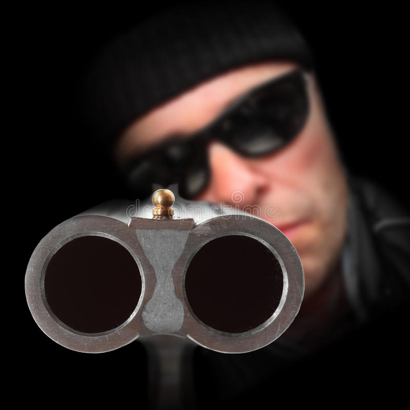 Gangster with shotgun aimed at you royalty free stock images