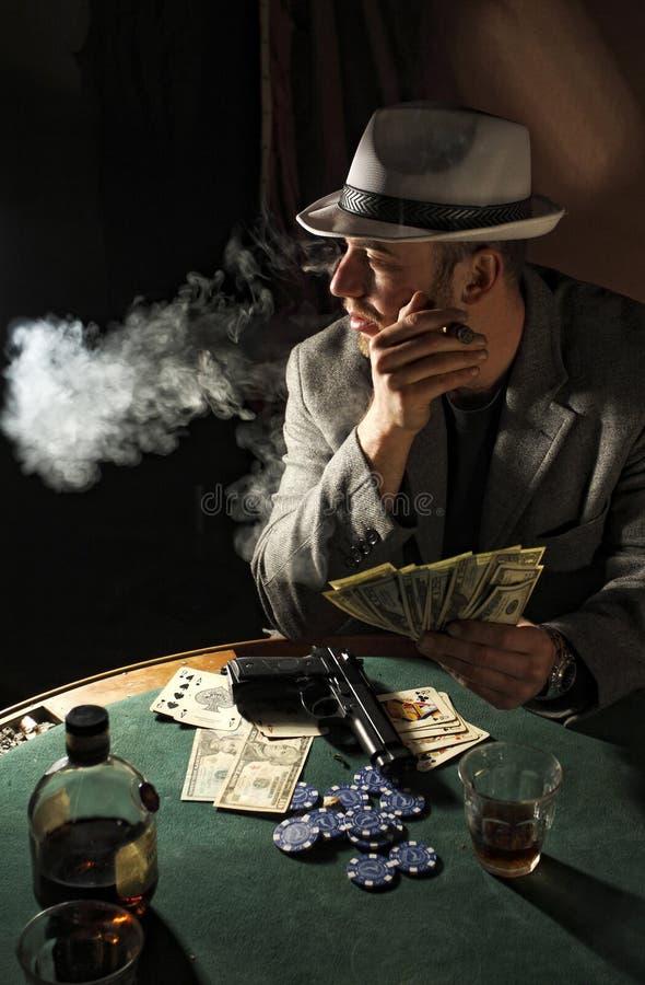 Gangster Smoking And Play Poker Stock Image