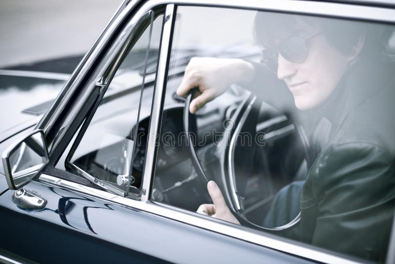 Gangster stories. Gangster waiting in a car stock photos