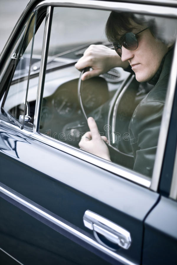 Gangster stories. Gangster waiting in a car stock images