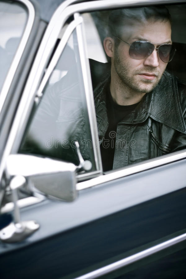 Gangster stories. Gangster waiting in a car stock image