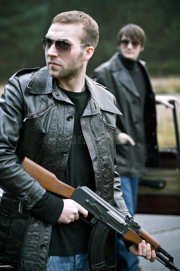 Gangster stories. Two gangsters clearing their way royalty free stock photo