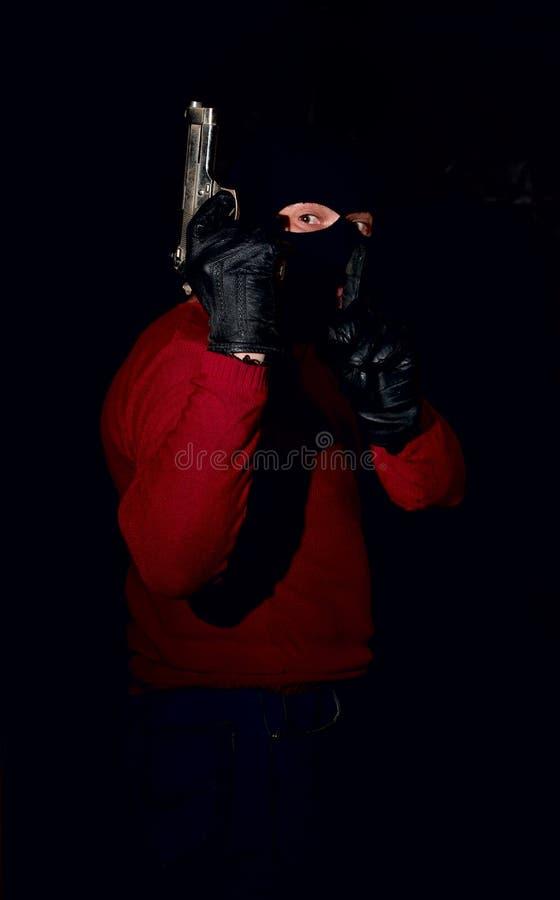 Gangster z pistoletem w masce zdjęcia stock