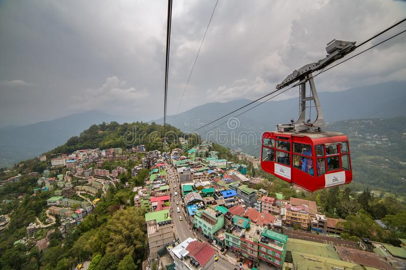 Tourists enjoy a ropeway cable car in Gangtok city in cloudy day. Gangtok, India - May 1, 2017: Tourists enjoy a ropeway cable car in Gangtok city in cloudy day stock image