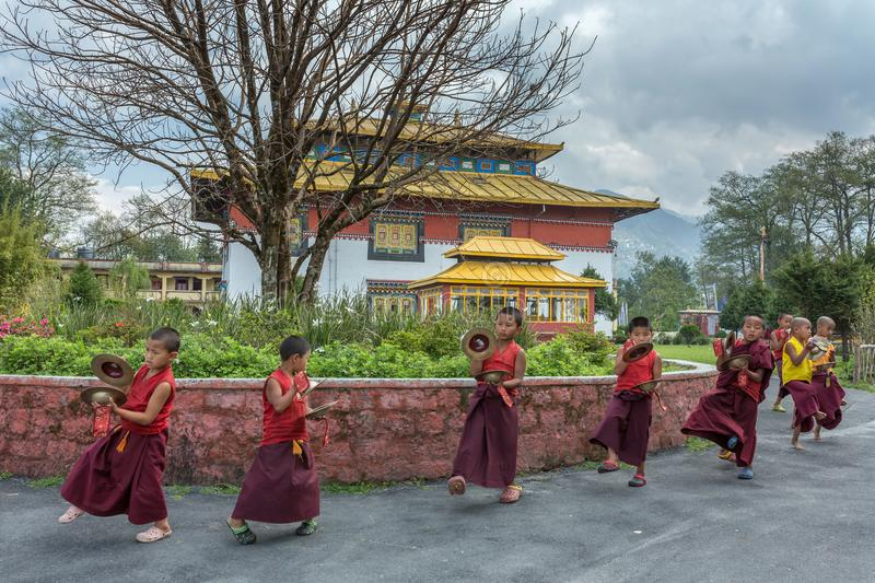 Unidentified young novice buddhist monks in Tsuglakhang monastery, Gangtok, Sikkim, India. Gangtok, India - May 3, 2017: Unidentified young novice buddhist monks stock image