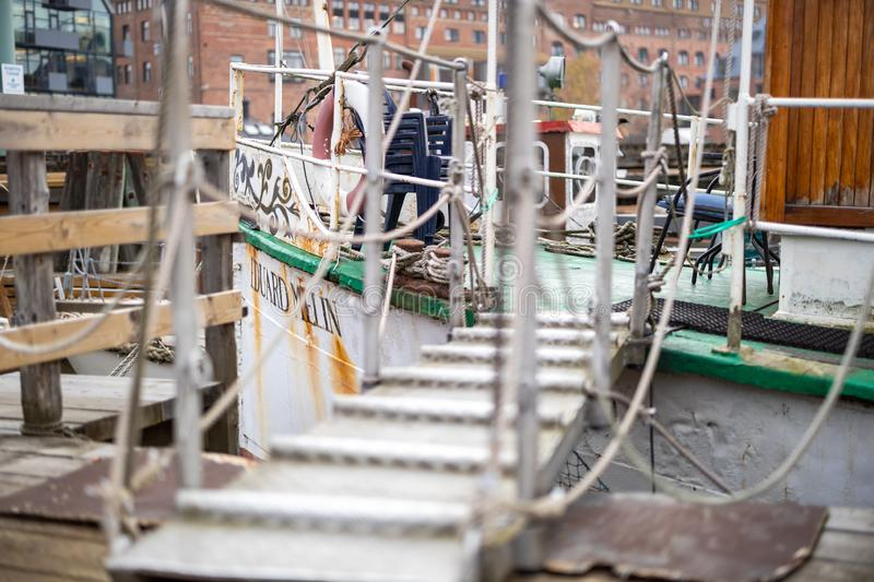 Gangway to older ship at the pier. Gangway to an cafe ship at the veteran boat association club at Klippans Steamboat jetty in Gothenburg, Sweden royalty free stock photography