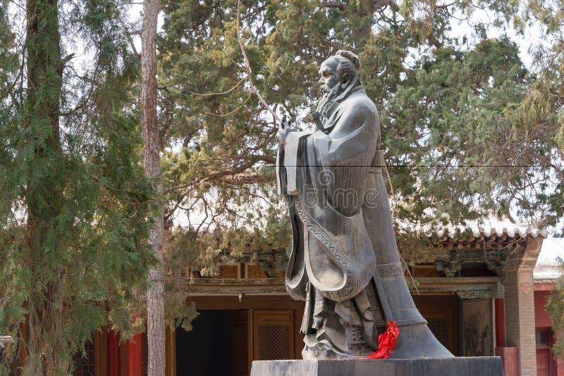 GANSU, CHINA - Apr 08 2015: Confucius Statue at Wuwei Confucian. Temple (Wuwei Wen Miao). a famous historic site in Wuwei, Gansu, China royalty free stock photo