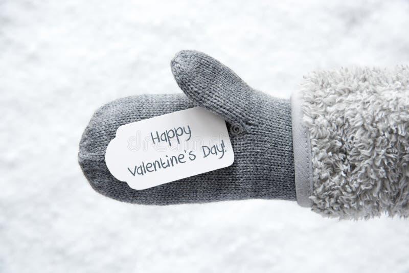 Gant de laine, label, neige, jour de valentines heureux des textes photos stock