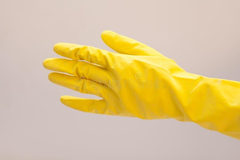 Gant de latex pour nettoyer à disposition photo libre de droits