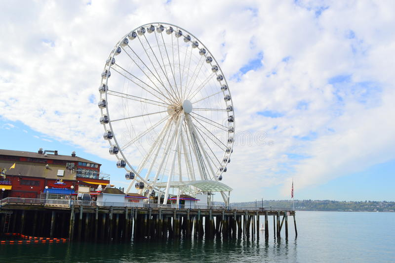 Gant Ferris wheel at Pier 57 in Seattle. The Seattle Great Wheel is a giant Ferris wheel at Pier 57 on Elliott Bay in Seattle, Washington. With an overall height stock photo