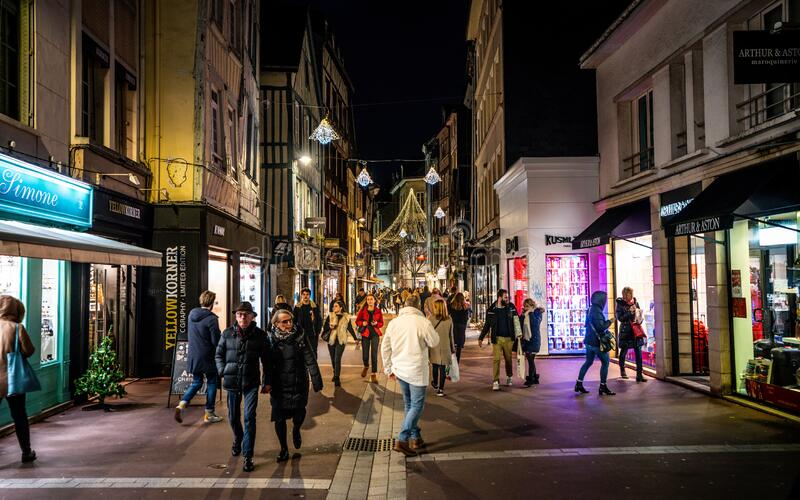 Ganterie pedestrian shopping street view in old Rouen district full of people at night in Rouen Normandy France royalty free stock images
