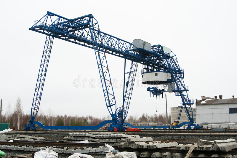 Gantry crane. Large gantry crane in between lifting stock image