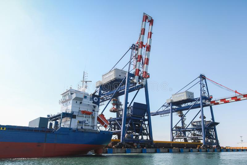 Gantry cranes and cargo ship royalty free stock photo