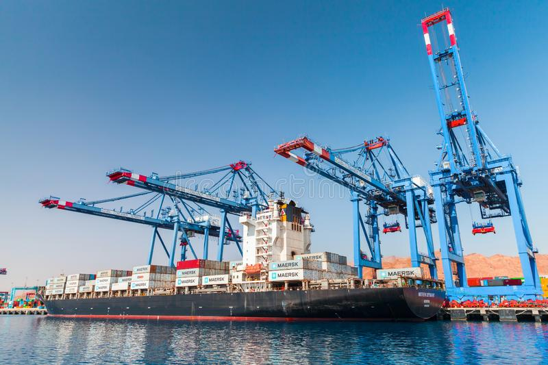 Gantry cranes load container ship royalty free stock photography