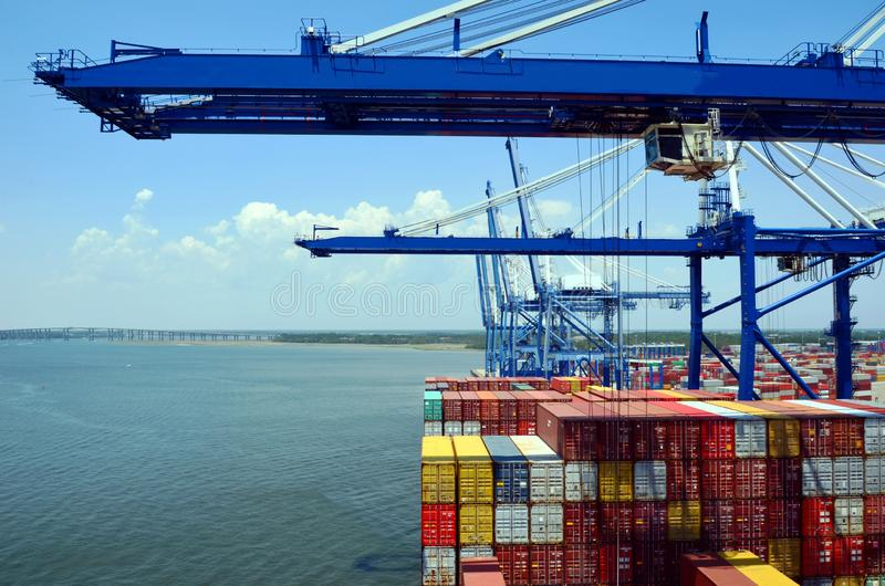 Gantry cranes are loading cargo on the container ship in port of Charleston, South Carolina. Gantry cranes are loading cargo on the big container ship in port stock photography