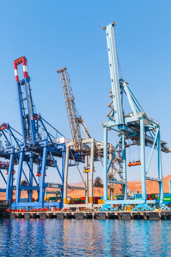 Gantry cranes stand in line. Aqaba, Jordan - May 18, 2018: Gantry cranes stand in line. Aqaba container terminal. Aqaba Bay, Jordan stock photo
