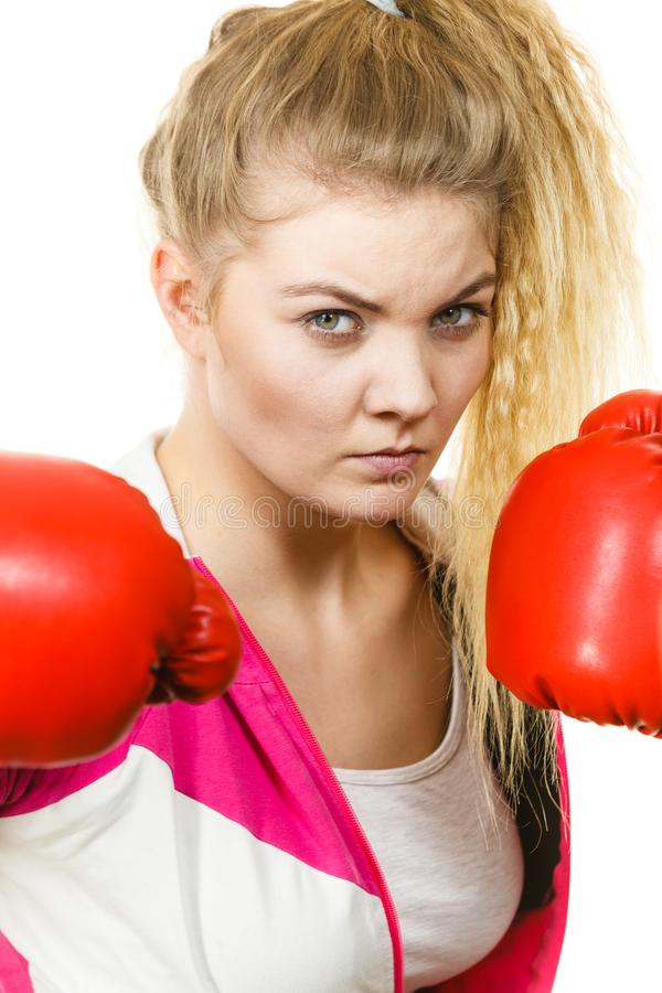 Gants de boxe s'usants de femme images stock