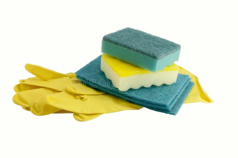 Gants et éponges jaunes en caoutchouc pour le lavage photos libres de droits