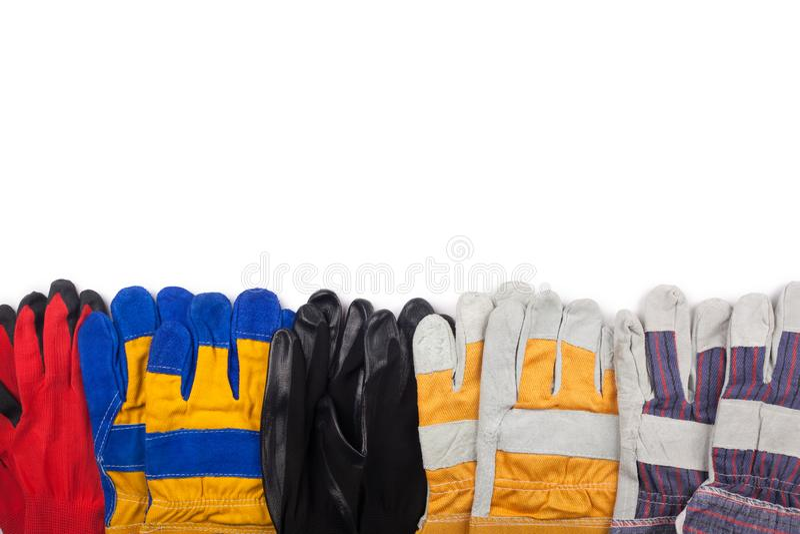 Gants protecteurs de travail sur le blanc photo stock