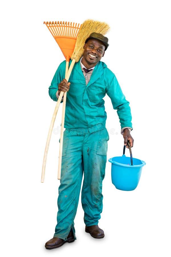 Ganzaufnahme der glücklichen afrikanischen Gartenarbeitskraft stockbild