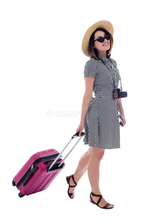 Ganzaufnahme des jungen Schönheitstouristen mit dem Koffer lokalisiert auf Weiß stockfoto