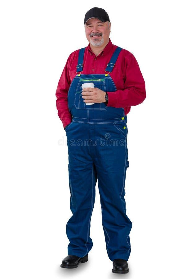 Ganzaufnahme einer Arbeitskraft in den Jeansstoffen stockbild