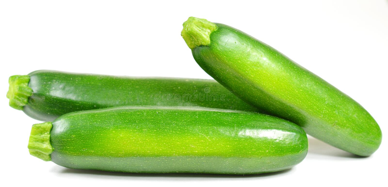 Ganze Zucchini lizenzfreie stockbilder