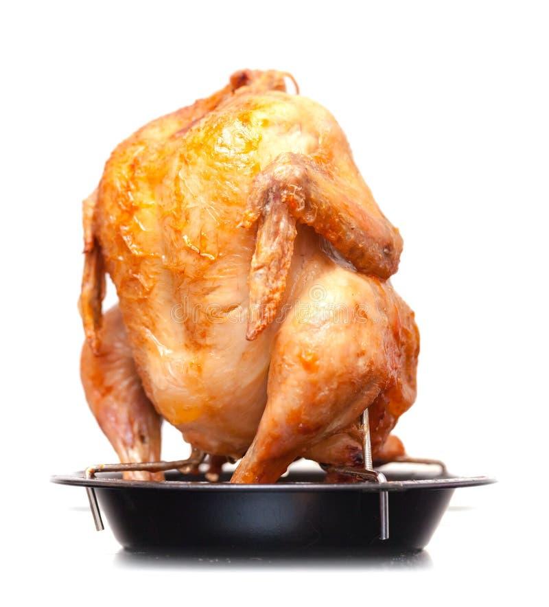 Ganzes gegrilltes Huhn auf schwarzer Metallwanne lizenzfreies stockfoto