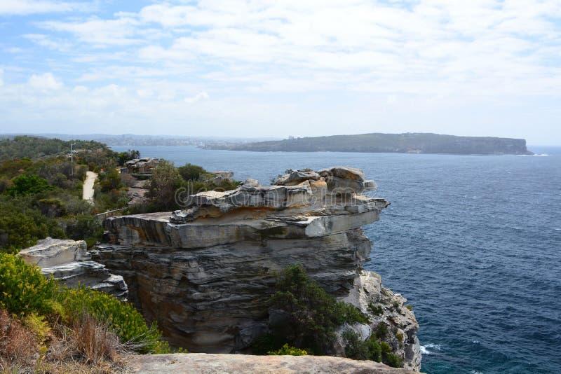 Gap fa il bluff la pista di camminata Baia di Watsons sydney Il Nuovo Galles del Sud l'australia immagini stock libere da diritti