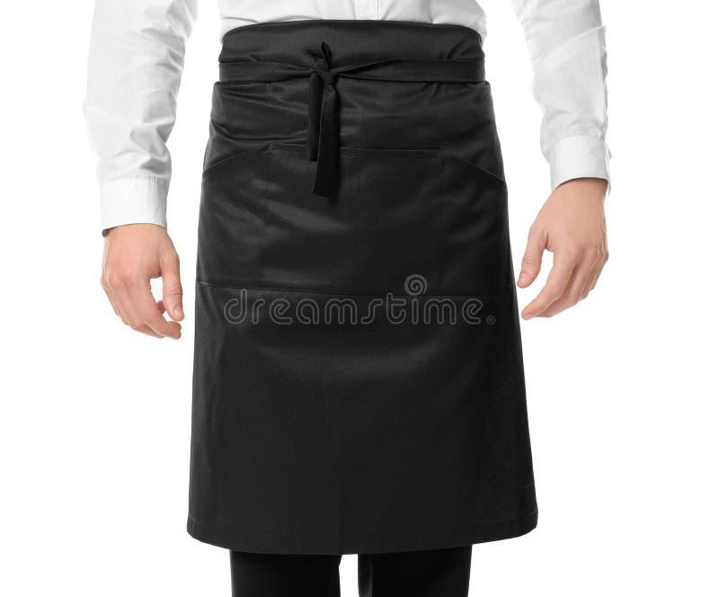 Garçom no avental preto imagem de stock royalty free