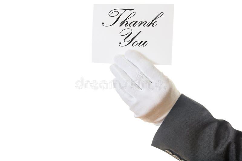 Garçom que guarda um agradecimento você para cardar no fundo branco fotografia de stock royalty free